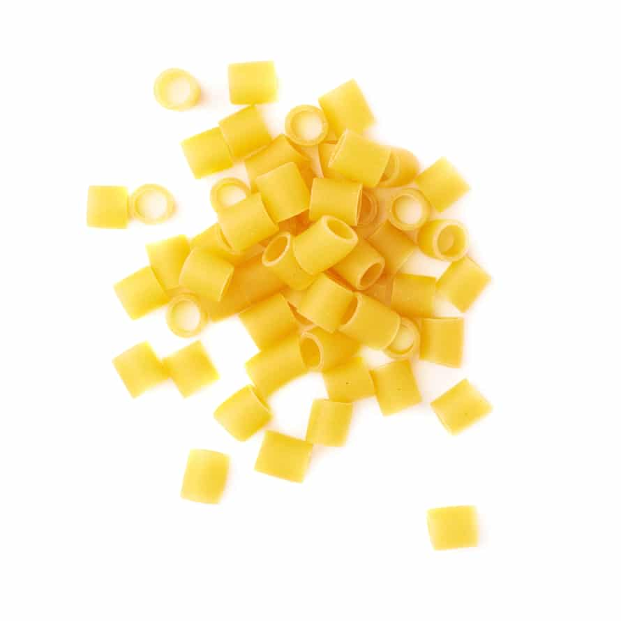 Pile of dry ditalini pasta over isolated white background