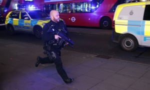 An armed policeman runs down Oxford Street to respond to an incident in November – which turned out to be a fist fight.