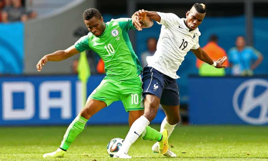Mikel John Obi battles for possession with France's Paul Pogba at the 2014 World Cup.