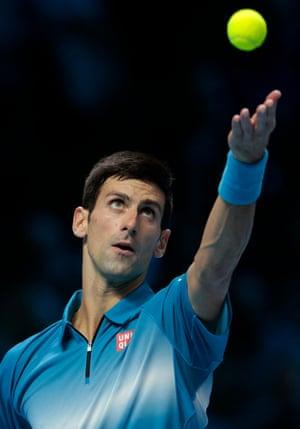 Djokovic serves.