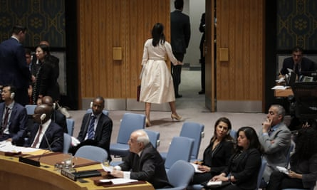 Haley walks out of the chamber as the permanent observer of Palestine to the UN, Riyad Mansour, begins to speak at a UN security council meeting on 15 May 2018.