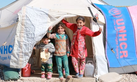 Children peek out from their tent in a refugee camp near Kirkuk, Iraq. Two mobile medical teams operate from the Medair base in Kirkuk.