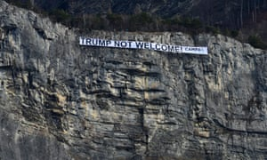 Campax protest against US President Trumpepaselect epa06473568 A handout photo made available by CAMPAX shows a banner with the inscription 'Trump not welcome!' hanging in a rock face of the Ellhorn mountain near Sargans, Switzerland, 25 January 2018. The campaign organisation Campax protested against US President Trump's visit to Switzerland. EPA/ANTONIO PANTE HANDOUT MAY ONLY BE USED WITH COMPLETE INDICATION OF THE SOURCE HANDOUT EDITORIAL USE ONLY/NO SALES