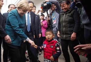 Angela Merkel<br>German Chancellor Angela Merkel , left, greets village children in Baohe district of Hefei, China, Friday, Oct. 30, 2015. (Johannes Eisele/Pool photo via AP)
