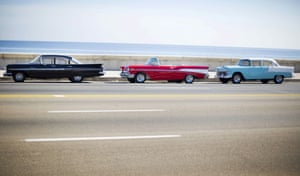 Havana, Cuba Vintage US-made cars are seen parked along the Malecon near the US embassy. Cuba's cash-strapped government has started selling cars in tradeable currencies rather than convertible Cuban pesos this month as it continues to dollarise swathes of its retail sector.