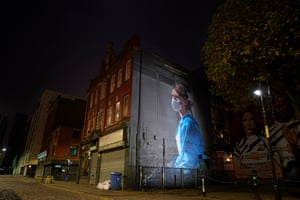 A mural depicting NHS nurse Melanie Senior, based on a photograph by Johannah Churchill, which the National Portrait Gallery commissioned artist Peter Barber to create in Manchester's Northern Quarter.