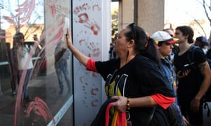 Red ochre is smeared on the windows of the supreme court in Sydney as part of the nationwide demonstrations that followed the three-year sentence handed to the man who ran over Elijah Doherty.