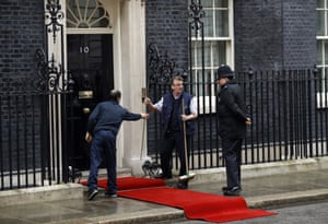 Workers prepare a red carpet outside 10 Downing Street