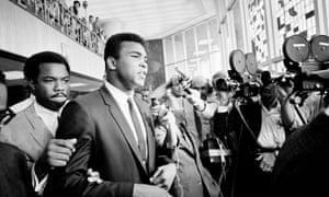 Muhammad Ali, leaving the federal building in Houston during a recess in his trial for refusing induction to the army in 1967.