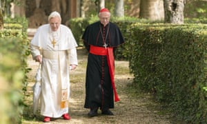 Jonathan Pryce as Cardinal Bergoglio, right, and Anthony Hopkins as Pope Benedict in a scene from The Two Popes.