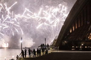 The Sydney Harbour fireworks display and a near-empty Opera House forecourt during the celebrations