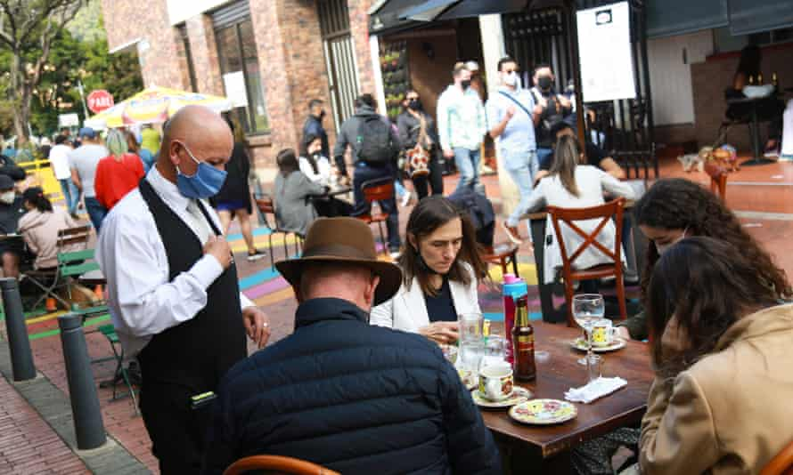Diners enjoy a meal outside in Bogota. Colombia only lifted nationwide restrictions at the start of September.
