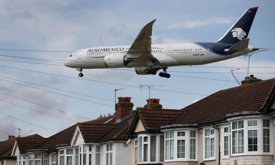 A passenger plane comes in to land at Heathrow airport, 2014