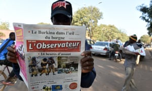 A man reads a newspaper in Ouagadougou after a deadly jihadist attack claimed by al-Qaida in the Islamic Maghreb in January.