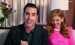 Sacha Baron Cohen, who won best actor in a motion picture musical or comedy for Borat Subsequent Moviefilm, with wife Isla Fisher