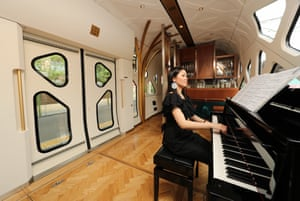 A pianist entertains passengers in the lounge