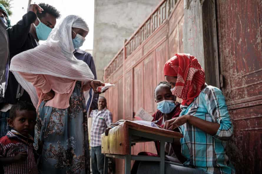 Ethiopians displaced by the violence in the Tigray region register for emergency food rations in Mekelle last month.