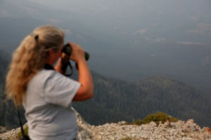 Duffey uses binoculars to get a better view