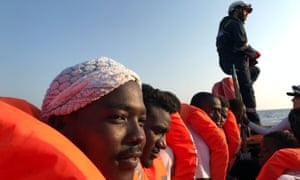 Migrants fleeing poverty and conflict in Africa are rescued after being stranded in the Mediterranean