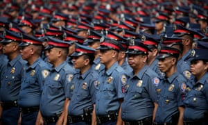 Newly promoted police officers in formation during a ceremony police HQ in Taguig city, south of Manila.
