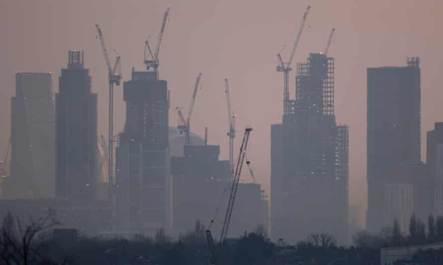 Skyscrapers and construction cranes