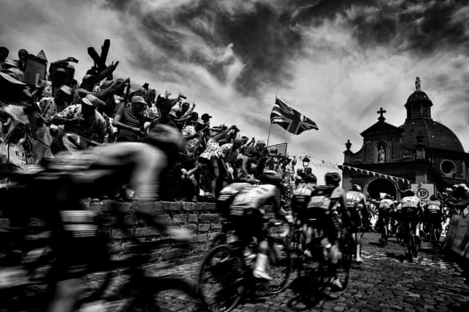 Riders from the pack in the Wall of Grammont - Mur de Grammont arrive at the chapel of Notre Dame de la Vieille Montagne - Our Lady of the Old Mountain in the first stage of the 106th edition of the Tour de France.