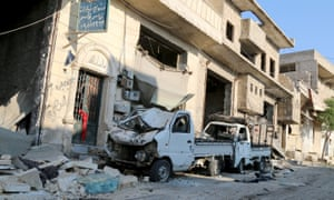 A damaged vehicle after a Syrian army helicopter belonging hit a residential area in Aleppo with barrel bombs.