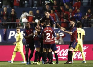 Osasuna's players celebrate.