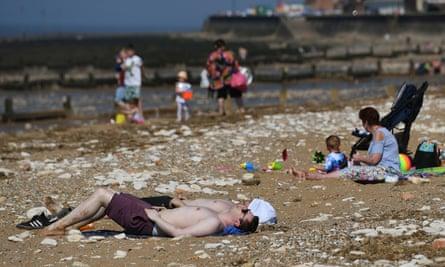 Sunbathers on Hunstanton beach in Norfolk