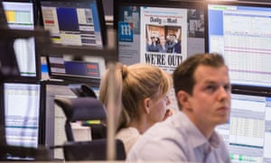 24 June, 2016: shocked traders on the Frankfurt stock exchange the day after the EU referendum, with the Daily Mail front page on a screen behind