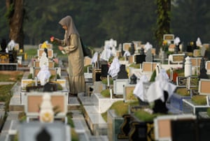 A woman visits a cemetery in Singapore