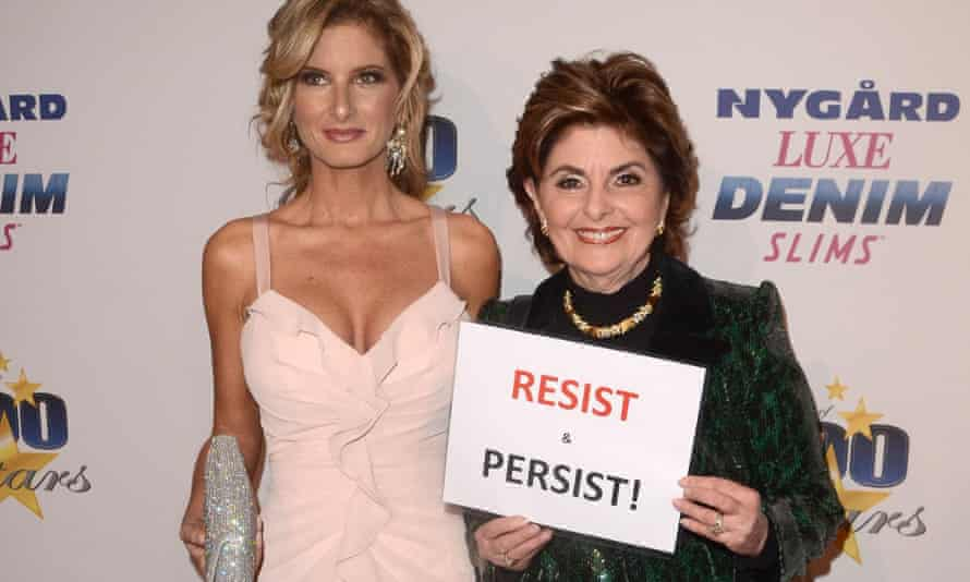 Summer Zervos with Allred holding a sign saying 'resist and persist'