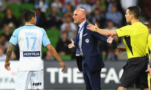 Tim Cahill and Kevin Muscat exchange words