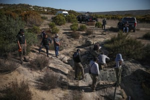 Forensic experts work with police protection during a search for the body of José Barajas last month. José was dragged from his ranch near the town of Tecate on 8 April, 2019 and has not been seen since