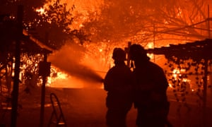 Firefighters battle the Saddleridge fire in Porter Ranch, California, on 11 October.