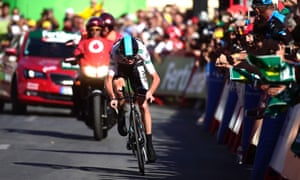 Chris Froome sprints to the line at the end of stage 19.