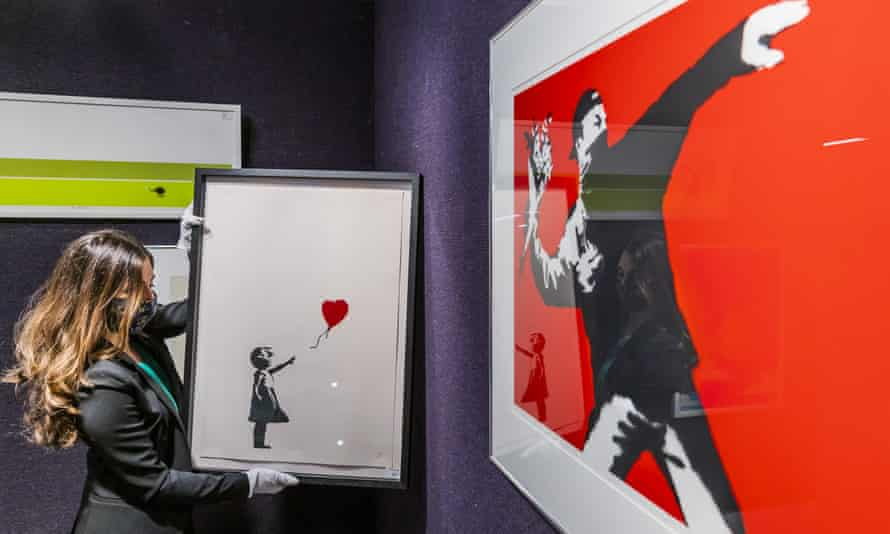 Versions of Banksy's Girl with Balloon and Love is in the Air at Bonhams' auction house in London