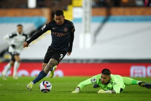 Gabriel Jesus of Manchester City runs past Fulham keeper Alphonse Areola to score his side's second goal.