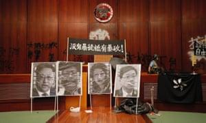 Defaced portraits of Hong Kong officials in the legislative council building