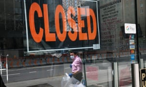 A closed sign in the window of a business in New York City