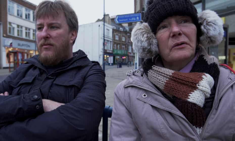 John Harris interviewing a homeless woman in Dover in 2018.
