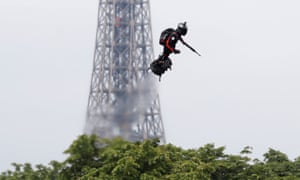 Franky Zapata soars on his Flyboard near the Champs-Élysées Avenue in Paris on Bastille Day, with the Eiffel Tower in the background,