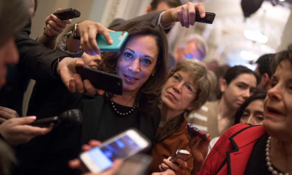 Kamala Harris, surrounded by reporters.