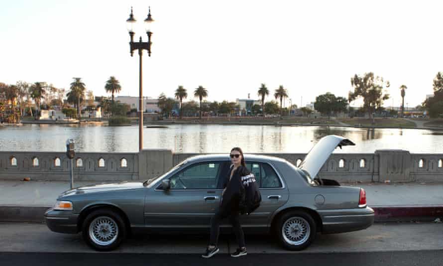 Artist Chanel Von Habsburg-Lothringen standing next to Gallery1993, an art space in a car.