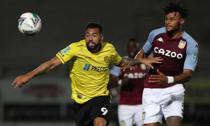 Kane Hemmings (left) tries to escape the attentions of Tyrone Mings during Burton's Carabao Cup game againt Aston Villa in September.