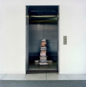 Stack of books on an elevator in an Upper West Side building, in NYC.