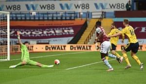 Villa's Keinan Davis should score but shoots wide.