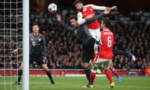 Arsenal's Olivier Giroud gets up well but heads just wide.