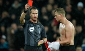 Referee Danny Makkelie shows a red card to Feyenoord's John Guidetti after taking off his shirt during the Eredivisie match with RKC Waalwijk on 18 February 2012.