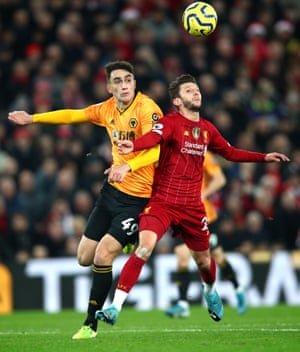 Adam Lallana of Liverpool controls the ball under pressure from Maximilin Kilman of Wolverhampton Wanderers leading to Liverpool's first goal.